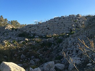 Fortification - Remains of a fortified village, Borġ in-Nadur, Malta. Borġ in-Nadur is a notable example of Bronze Age-fortifications.