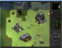 On the right is a small vertical panel witch icons and a small map. The remaining three quarters of the screen is a digital depiction of grass plain, with black and grey areas to represent unexplored regions. Three metallic looking buildings are placed on the plain, surrounded by military vehicles and personnel. Certain units have gauges above them, representing their state of damage.