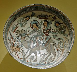 Persian pottery - Bowl with a hunting scene from the tale of the 5th-century king Bahram Gur and Azadeh, mina'i ware