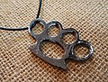 Brass knuckle - pendant.JPG