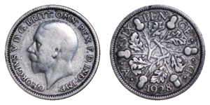 Sixpence (British coin) - Obverse and reverse of the 1928 sixpence, depicting George V.