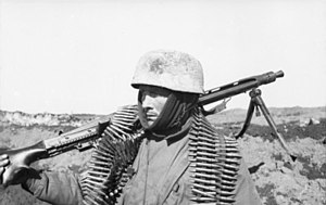 Fallschirmjäger (World War II) - German paratrooper of the PK XI Flying Corps carrying a MG 42 machine gun in the Soviet Union in 1942