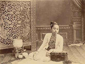 Burmese clothing - In this colonial-era photo, a woman is dressed in a yinkhan (bodice), and htaingmathein (jacket).