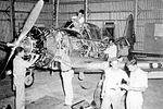 Bush Field - Vultee BT-13 in hangar for major maintenence.jpg