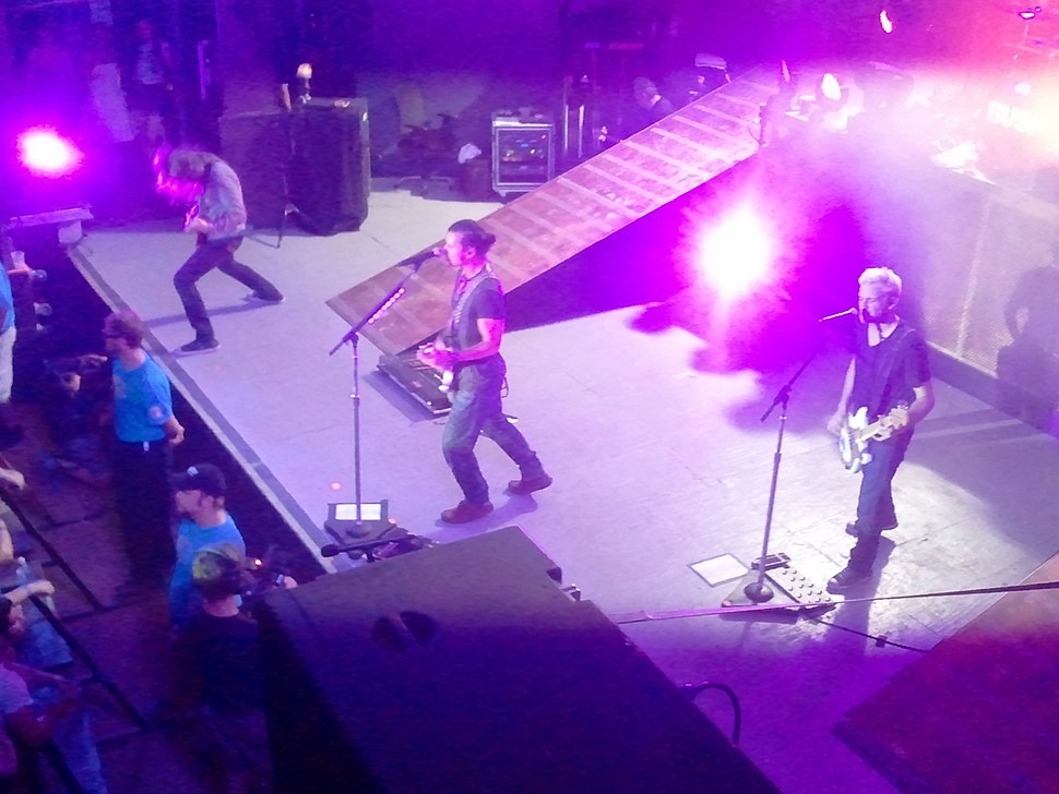 A rock band performing onstage