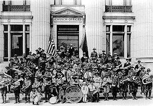 Young Men (organization) - Mutual Improvement Association Scouts in front of the Church Administration Building, c. 1917. With the organization of the Boy Scouts of America in 1910, the LDS Church organized the MIA Scouts a year later, and became one of the first sponsoring organization of the BSA in 1913.