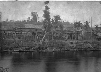 Dayak people - The Dayak longhouses along the Kahayan River taken in Tumbang Anoi village (c. 1894), the village witnessed the Tumbang Anoi Agreement 20 years earlier in 1874 that ended the headhunting practise by the Dayak people in Dutch Borneo (Kalimantan).