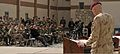Canadian Army Brig. Gen. Wayne Eyre, at lectern, the incoming commander of NATO Training Mission-Afghanistan (NTM-A), addresses joint coalition forces during a transfer of authority ceremony March 10, 2014 140310-N-ZZ999-005.jpg