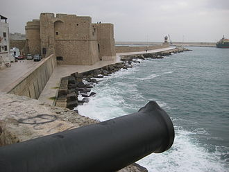 Monopoli - The Charles V castle behind the cannons of the bastion S.Maria