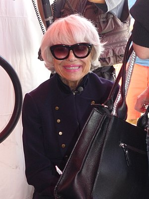 Carol Channing preparing to speak to an adorin...