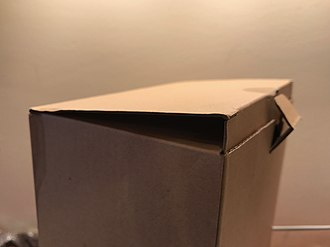 Corrugated box design - Partially open; showing tuck flap and locking tab (tongue)