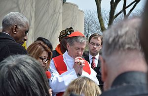 Blase J. Cupich - Cupich praying at a 2017 Good Friday demonstration against gun violence in Chicago