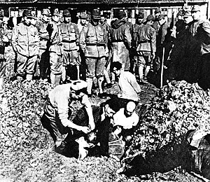 Premature burial - Chinese civilians being buried alive by Japanese soldiers during the Nanking Massacre