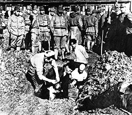 Chinese civilians being buried alive by soldiers of the Imperial Japanese Army, during the Nanking Massacre, December 1937 Chinese civilians to be buried alive.jpg