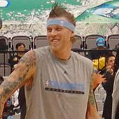 Chris Andersen, a Caucasian male with spiked brown hair, is smiling.