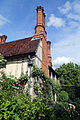 Church of Ss Mary & Lawrence - churchyard east cottage side.JPG