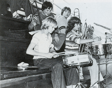 Cobain playing drums at an assembly at Montesano High School