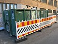 Construction fence and dumpster (41437532804).jpg