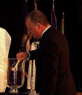 Alpha Phi Omega - Past National President, Dr. Fred Heismeyer, lights the convention's eternal flame at the 2006 APO-USA national convention in Louisville, Kentucky.