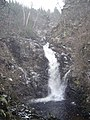 Corrimony Falls in a snow shower - geograph.org.uk - 864851.jpg