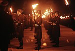 DF-ST-88-08721 Members of the German military carry lit torches in honor of General (GEN) Charles L. Donnelly Jr. 1987.jpeg