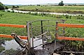 Damaged kissing gate to River Dearne at Barnburgh, South Yorkshire.jpg