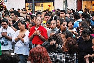 Santa Muerte - Devotees praying to Santa Muerte, Mexico.