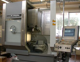 Milling (machining) - Five-axis machining center with rotating table and computer interface