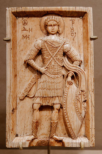 Byzantine army (Komnenian era) - St. Demetrios (Byzantine ivory icon, c. 1000). The saint is shown wearing a lamellar klivanion with splint armour defences for the upper arms incorporating plate pauldrons, the splint kremasmata defences for the hips and thighs match the arm defences. The bare legs are a classical convention