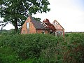 Derelict farm building by Badgers Farm - geograph.org.uk - 244253.jpg