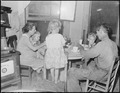 Dillard Eldridge, his wife and children, at supper in the four room house for which they pay $9 monthly. This is one... - NARA - 541209.tif