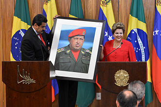 Dilma Rousseff - Rousseff receiving a photograph of Hugo Chávez from Nicolás Maduro at the Planalto Palace, 9 May 2013.