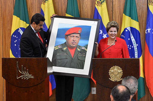 Dilma Rousseff receiving a Hugo Chávez picture from Nicolás Maduro