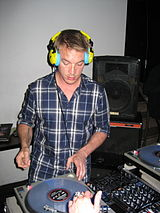 Diplo playing at a DJ booth.