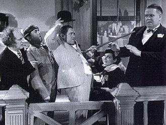 The Three Stooges - Larry Fine, Moe Howard and Curly Howard in Disorder in the Court (1936), one of three frequently telecast Stooges shorts in the public domain.