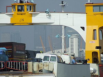 Woolwich Ferry - Traffic boarding the James Newman. The ferry service is important for HGVs owing to restrictions in the Blackwall Tunnel and northbound Dartford Crossing.