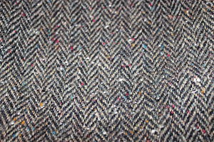 Donegal tweed - Donegal Tweed fabric. With the characteristic small pieces of yarn in different colours.
