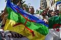 Drapeau berbère porté par un militant algérien.jpg