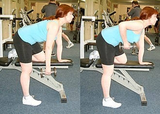 Bent-over row - A one arm bent-over dumbbell row with a bench used as support.
