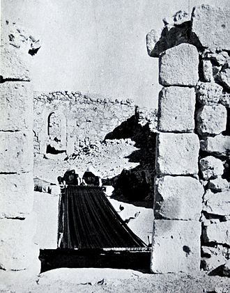 Dura, Hebron - Women weaving carpet on a ground loom in Dura, 1930s