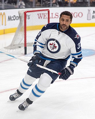 Winnipeg Jets - Dustin Byfuglien with the Jets in the 2015–16 season. The Jets signed Byfuglien to a five-year extension in the 2015 off-season.