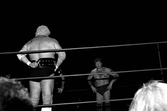 Harley Race - Dusty Rhodes prepares to face Race (in the background) in 1979