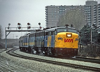 Scarborough Village - A Via Rail train passed through the rail lines at the northern boundary of the neighbourhood, 1981. The opening of the rail line in 1930 saw a drop in traffic on Kingston Road.