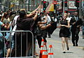 Emma Watson running to her fans.jpg