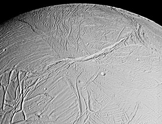 Enceladus - View of Enceladus's Europa-like surface with the Labtayt Sulci fractures at center and the Ebony and Cufa dorsa at lower left, imaged by Cassini on February 17, 2005