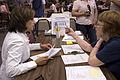FEMA - 36465 - Nancy Montanez-Johner and a FEMA worker at a DRC in Iowa.jpg
