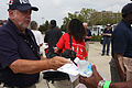 FEMA - 38106 - FEMA employee passing out fliers to evacuees returning to Louisiana.jpg