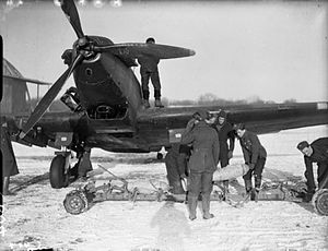 Fairey Battle - Ground crew unloading 250-lb GP bombs in front of a Battle, circa 1939-1940