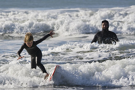 Young grommet on a board with his dad watching. Father and son surf lesson in Morro Bay, CA 11 of 12.jpg