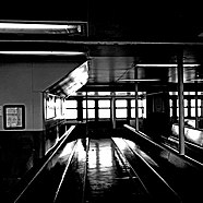 """Interior of the MV """"John F. Kennedy"""" in 2018, pictured in black and white"""